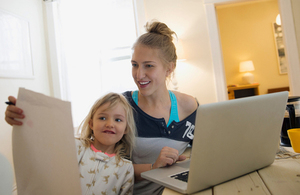 Tax Credits renewals - mother on laptop and daughter