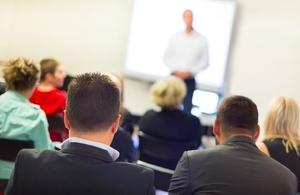 speaker presenting at business workshop