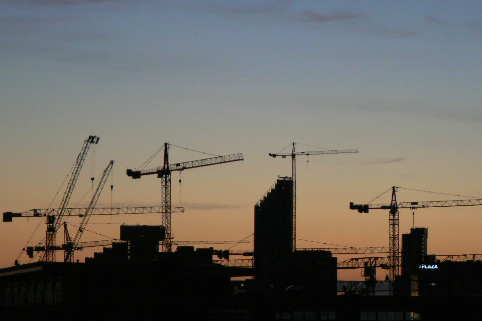 Silhouettes of cranes against the skyline (credit: peterallen/CC BY-SA 2.0)