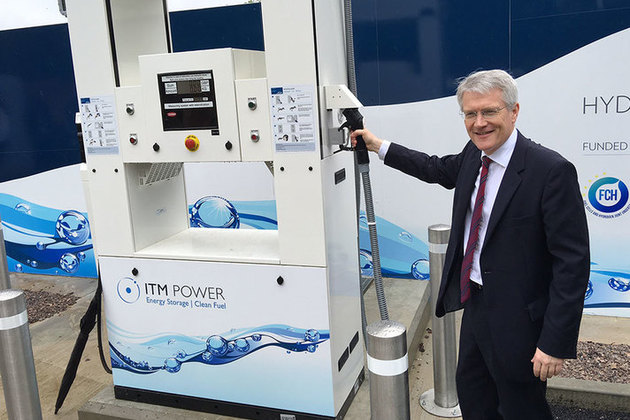 Minister Andrew Jones with hydrogen refuelling station.