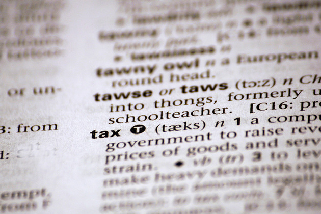 image of dictionary definition of tax