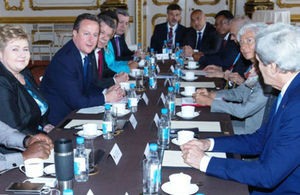 Tanzanian PM  with British PM and other world leaders at the London Anti Corruption Summit, 12th May