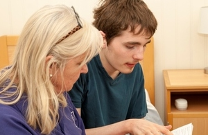 Young man and carer in residential care