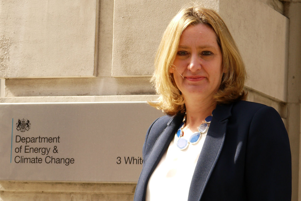 Amber Rudd in front of DECC building