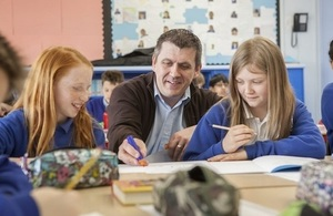 Teacher and pupils talking.