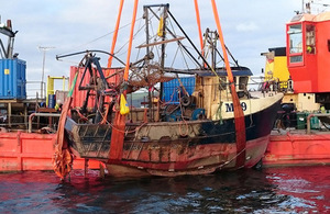Fishing vessel JMT being recovered from the water