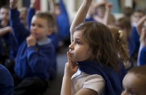 Pupils sat on the floor listening.