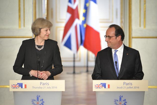 Prime Minister Theresa May speaking in Paris alongside President Hollande of France.
