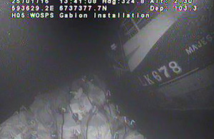 Underwater image of sandbags positioned against the wreck of Majestic