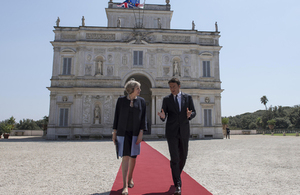 Prime Minister Theresa May with Italian Prime Minister Matteo Renzi walking on a red carpet outside Villa Doria Pamphili in Rome, Italy.
