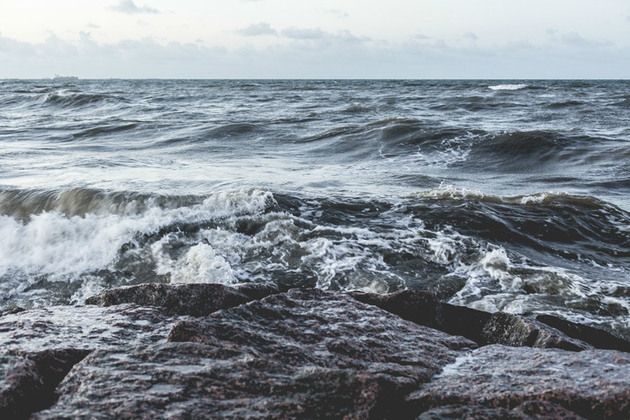 View of waves hitting rocks