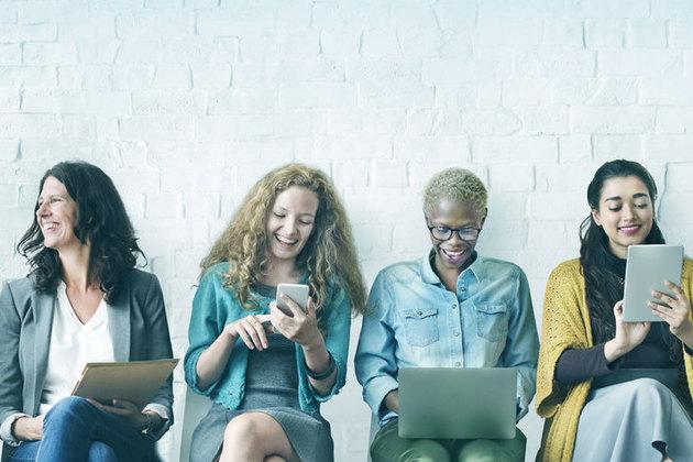 four women sitting in a row