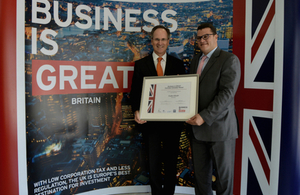 The British Ambassador Philip Parham presents the award to Founder and CEO of Novosci Dr. Nader Khedr.