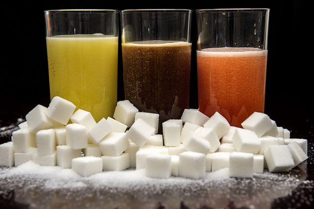 Soft drinks and piles of sugar