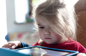 Child playing with tablet.