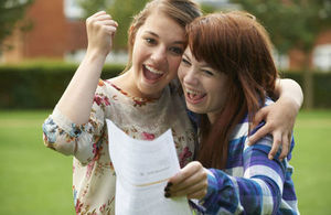 young people with their exam results