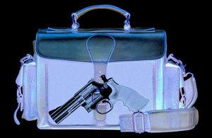 gun in a handbag