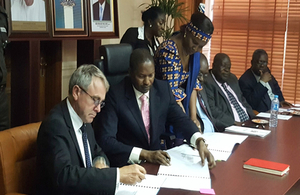 Immigration Minister signing agreement with Nigeria