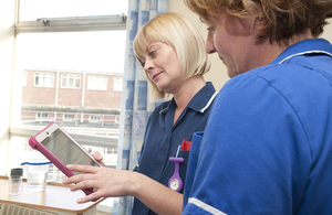 Nurses using an iPad