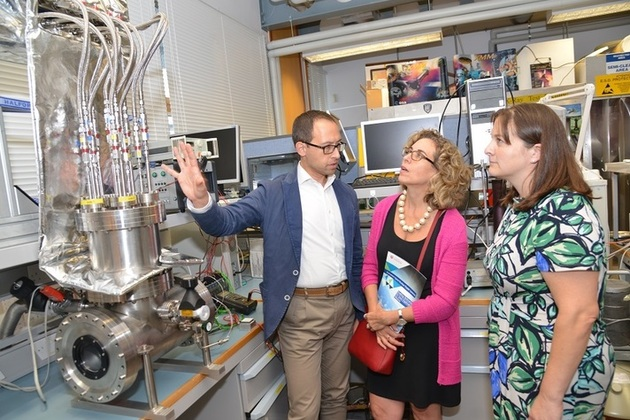 UK Space Agency CEO Katherine Courtney tours University of Leicester labs.
