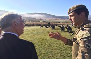 Defence Secretary Michael Fallon with Lt Edmund Harmer of 4 Platoon 2 Company Grenadier Guards at Biza training area
