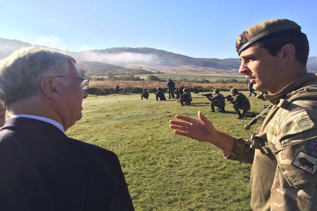 Defence Secretary Michael Fallon with Lt Edmund Harmer of 4 Platoon 2 Company Grenadier Guards at Biza training area