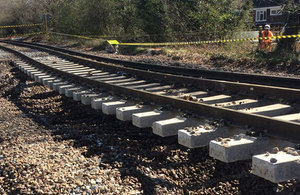 rail line cordoned off with workers inspecting