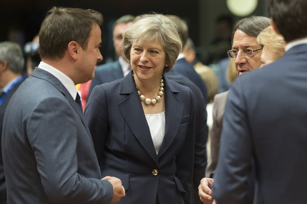 Prime Minister Theresa May talking with other European leaders at the European Council.