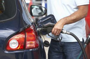 Man putting fuel in car
