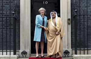 Prime Minister Theresa May standing outside 10 Downing Street with the King of Bahrain.