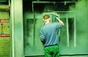 Prisoner in a paint workshop