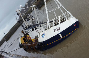 Fishing vessel Fredwood sunk alongside quay, photograph courtesy of News & Star