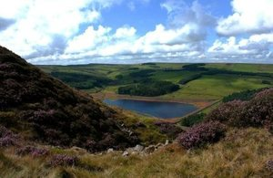 Sunny moorland view looking down onto Calf Hey reservoir