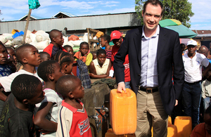 Minister James Wharton meets beneficiaries at UK aid funded water and sanitation facility in Eastern DRC. Photo: Alexandra Jonnaert / Mercy Corps