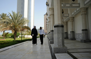 Two men walking on a paved area