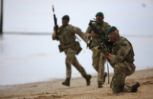 Royal Marines performing a beach assault. Crown copyright.