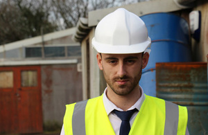 Man in hard hat and fluorescent vest.