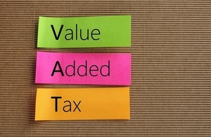 Three strips of coloured paper with the words 'value add tax' written on them