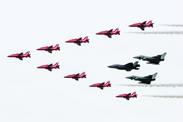 The Royal Air Force aerobatic team, The Red Arrows, performing a fly past in formation with the RAF F35B and a pair of Typhoons. Crown Copyright. Photo: via MOD.