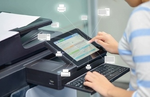 office worker using printer to scan