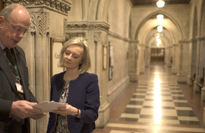 Elizabeth Truss meeting a member of court staff