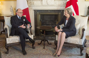 Prime Minister Theresa May speaking with Prime Minister Cazeneuve of France.