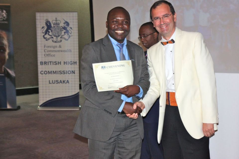 British High Commissioner Fergus Cochrane-Dyet presents certificates to returing scholars
