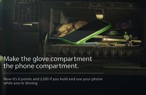 Mobile phone in glove compartment.