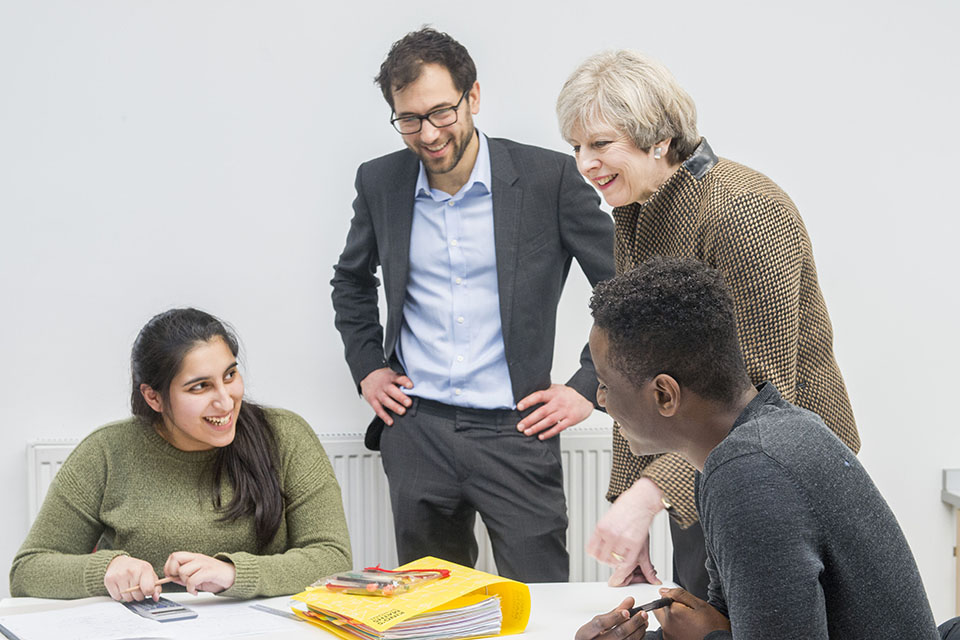 Prime Minister Theresa May speaking with students at the King's College London Mathematics School