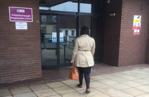 Lady walking into a court building