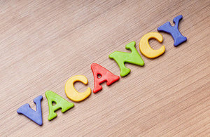 Vacancy text on a wooden board.