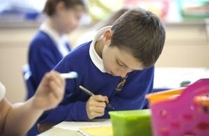 Male pupil writing