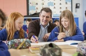 Male teacher with pupils KS2