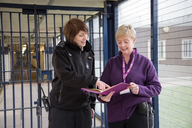 Prison officer and probation officer in conversation